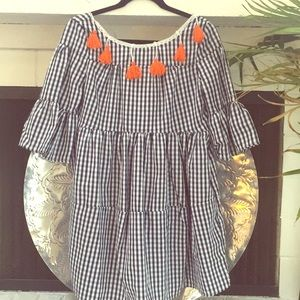 Blue and white checked tunic with orange pom poms